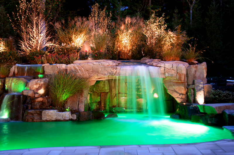 12 incredible summer landscape lighting ideas for Fancy swimming pool designs