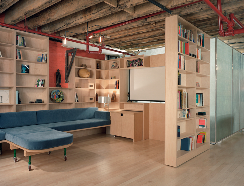 minimalist-comfortable-blue-sofa-bed-with-wheels-in-amusing-small-basement-remodeling-ideas-also-wall-shelving-system-and-bookshelf-along-with-glossy-laminate-wood-floor-beam-ceiling